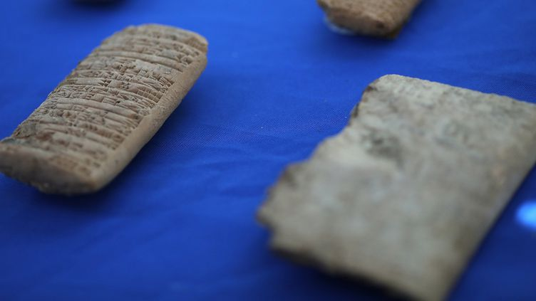 Les antiquités mésopotamiennes ont été officiellement restituées à l'Irak lors d'une cérémonie organisée par le bureau américain des douanes  (WIN MCNAMEE AFP)