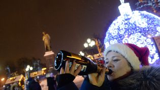 Qui dit nouvel an, dit Champagne, y compris à Moscou (Russie), où cette photo a été prise, quelques minutes après le passage à l'an 2015. (ARTEM ZHITENEV / REUTERS )
