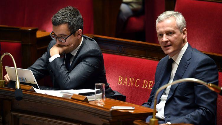 Le ministre de l'Action et des Comptes publics, Gérald Darmanin, et le ministre de l'Economie, Bruno Le Maire, le 24 octobre 2017 à l'Assemblée nationale. (ERIC FEFERBERG / AFP)