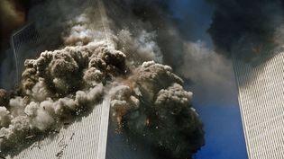 Le 11 septembre à New York en 2001, deux avions s'abattaient sur les tours du World Trade Center, faisant2.977 morts. (MAXPPP)
