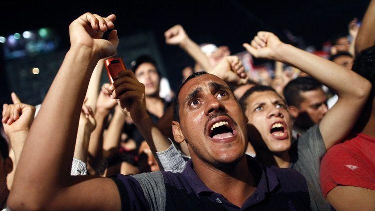 Des partisans du président déchu Mohamed Morsi manifestent au Caire, dimanche 7 juillet. (MAHMOUD KHALED / AFP)