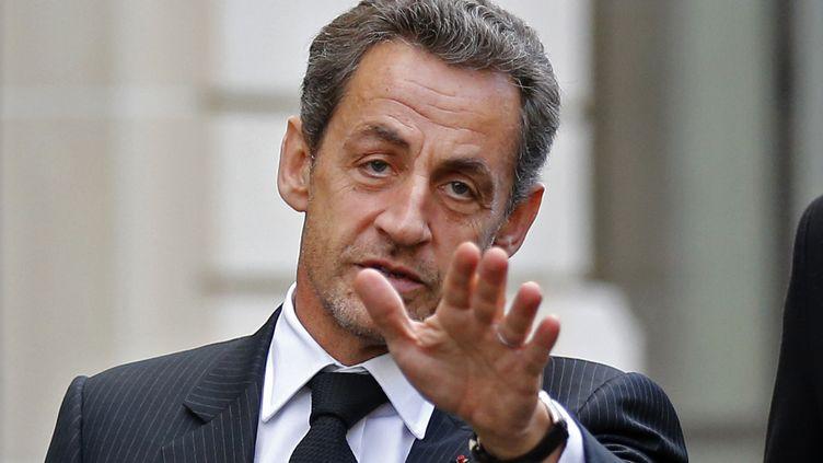 L'ex-président de la République Nicolas Sarkozy, à Paris, le 26 novembre 2012 après un déjeuner avec François Fillon. (BENOIT TESSIER / AFP)