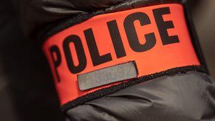 Un brassard de police à Marseille, le 12 avril 2019. (CHRISTOPHE SIMON / AFP)
