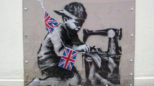Le capitalisme vu par Banksy. Ce graff avait disparu de son mur, il est mystérieusement réapparu lors de vente aux enchères à Miami.  (EPA/MAXPPP)