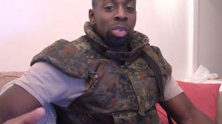 Capture d'écran d'une vidéo diffusée par le jihadiste Amedy Coulibaly, le 11 janvier 2015. ( AFP )