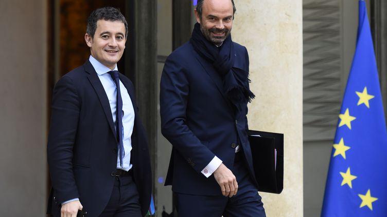 Gérald DarmaninetEdouard Philippe, à la sortie de l'Elysée, le 13 décembre 2017. (BERTRAND GUAY / AFP)