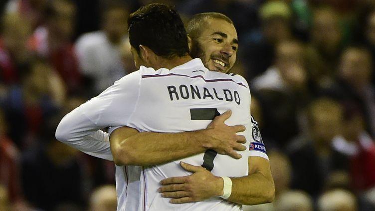 Cristiano Ronaldo et Karim Benzema, buteurs d'un soir à Anfield. (PIERRE-PHILIPPE MARCOU / AFP)