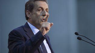 L'ancien président Nicolas Sarkozy lors d'un meeting à Boulogne-Billancourt, (Hauts-de-Seine), le 25 novembre 2014. (MARTIN BUREAU / AFP)