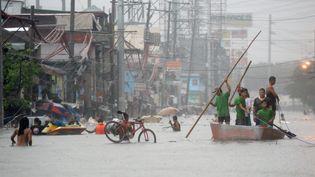 Manille (Philippines) sous les eaux après le passage de la tempête tropicaleFung-Wong, le 19 septembre (TED ALJIBE / AFP)