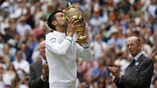 Le Serbe Novak Djokovic a remporté la finale de Wimbledon contre Matteo Berrettini, dimanche 11 juillet 2021. (ADRIAN DENNIS / AFP)