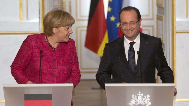 Conférence de presse conjointe de Franc ois Hollande et d'Angela Merkel à l'Elysee le 30 mai 2013 (JACQUES BRINON / AP / SIPA)