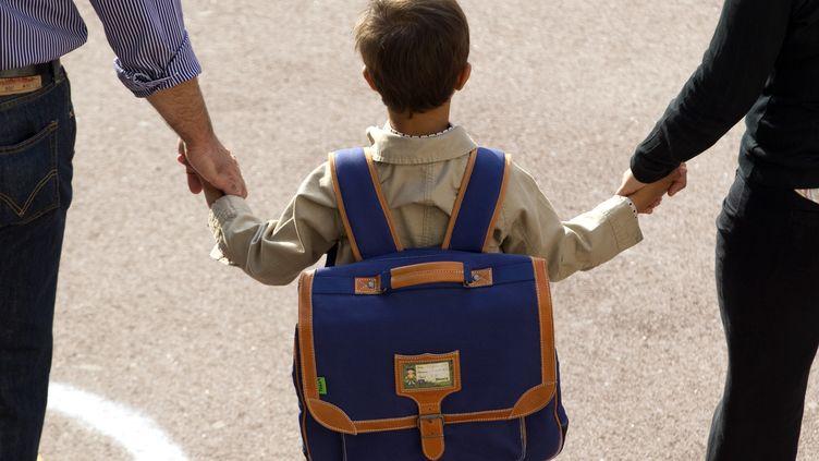 Arrivée à l'école primaire, à Vincennes, à la rentrée 2012. (CHARLES PLATIAU / REUTERS)
