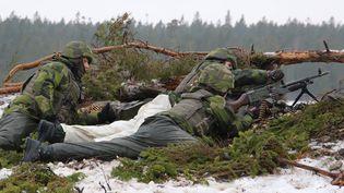Des militaires suédois à l'entrainement. Photo d'illustration. (TOM LITTLE / AFP)