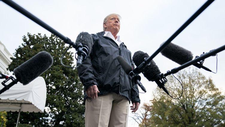 Le président américain Donald Trump face à des journalistes, à la Maison Blanche, à Washington, le 17 novembre 2018. (JIM LOSCALZO / CONSOLIDATED NEWS PHOTOS / AFP)