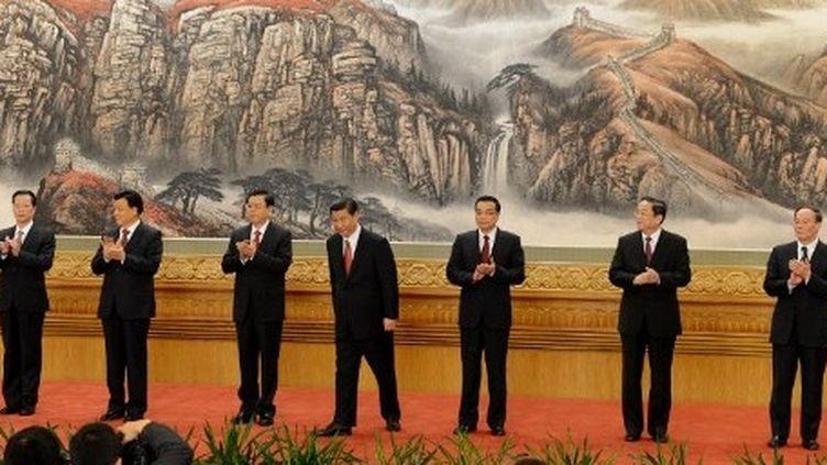 Les sept nouveaux dirigeants du PC chinois. (AFP/MARK RALSTON)