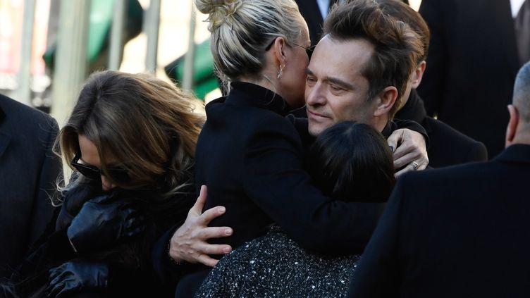 Laeticia et David, lors des obsèques de JohnnyHallyday, à Paris, le 9 décembre 2017. (BERTRAND GUAY / AFP)
