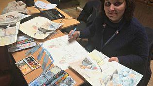 La dessinatrice de France Télévisions, Elisabeth de Pourquery, au tribunal correctionnel de Lille (Nord), le 16 février 2015. (CATHERINE FOURNIER / FRANCETV INFO)