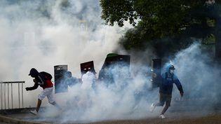 Des manifestants lors de rassemblements antigouvernementaux à Cali (Colombie), le 22 mai 2021. (LUIS ROBAYO / AFP)
