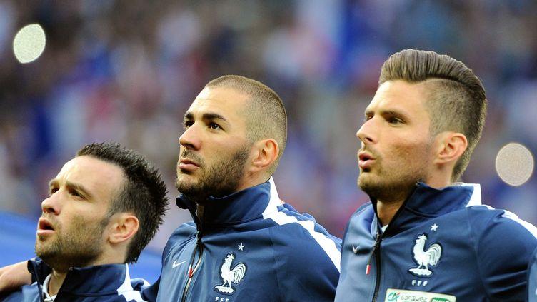Mathieu Valbuena, Karim Benzema et Olivier Giroud, le 8 juin 2014, au stade Pierre-Mauroy de Villeneuve-d'Ascq (Nord). (PHILIPPE HUGUEN / AFP)