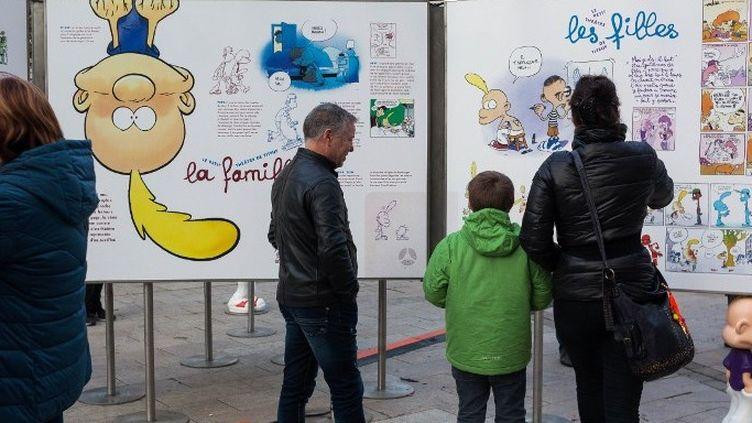 Visiteurs devant l'exposition pour les 25 ans de Titeuf au 45e Festival de bande-dessinée d'Angoulême (2018)  (Yohan Bonnet / AFP)