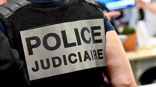 Un agent de la police judiciaire, en septembre 2021. (DENIS CHARLET / AFP)