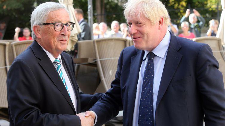 Le président de la Commission européenne, Jean-Claude Juncker, et le Premier ministre britannique, Boris Johnson, le 16 septembre 2019 à Luxembourg. (FRANCOIS WALSCHAERTS / AFP)