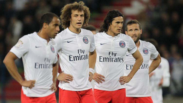 Les joueurs parisiens soudés (CHARLY TRIBALLEAU / AFP)
