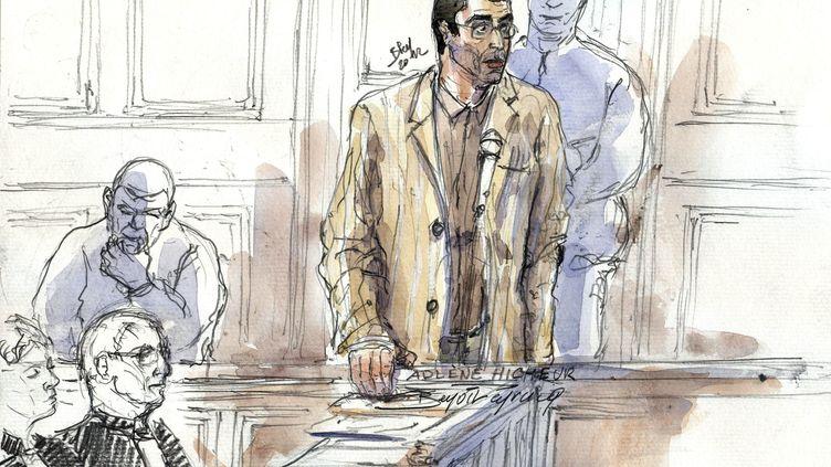 Le physicien franco-algérien Adlène Hicheur, soupçonné d'avoir envisagé des attentats contre la France, lors de son procès au tribunal correctionnel de Paris, le 29 mars 2012. (BENOIT PEYRUCQ / AFP)