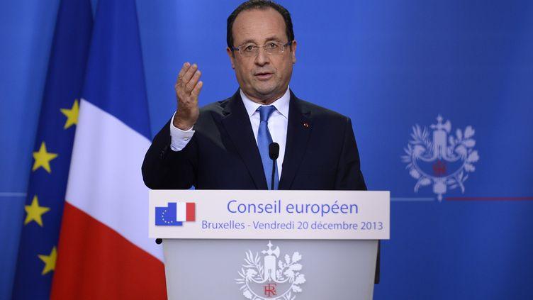 François Hollande lors d'une conférence de presse à Bruxelles (Belgique), le 20 décembre 2013. (LIONEL BONAVENTURE / AFP)