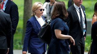 La candidate démocrate Hillary Clinton arrive aux commémorations des attentats du World Trade Center, le 11 septembre 2016 à New York. (BRIAN SNYDER / REUTERS)