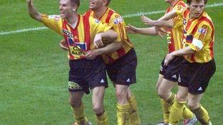Jérôme Dutitre, Fabrice Baron, Emmanuel Vasseur et Réginald Becque le 7 mai 2000 au Stade de France, en finale de Coupe de France. Calais vient d'ouvrir le score, mais s'inclinera face à Nantes (2-1). (PASCAL GEORGE / AFP)