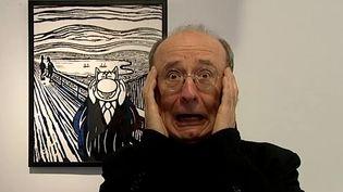 Philippe Geluck s'amuse à imiter le chat imitant lui même le Cri de Munch  (France Télévisions/culturebox )