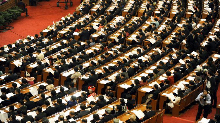 Les délégués chinois lors d'une session de l'Assemblée populaire nationale à Pékin, le 11 mars 2010. (LIU JIN / AFP)