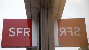 Une enseigne SFR (illustration). (SAMEER AL-DOUMY / AFP)