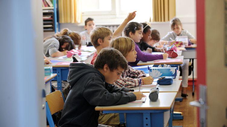 L'allocation de rentrée scolaire concerne 3 millions de familles, selon la ministre de la Famille, Dominique Bertinotti. (FRANK PERRY / AFP)