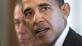 Barack Obama, le président américain, lors d'une réunion avec une délégation bipartisane de parlementaires à Washington (Etats-Unis),pour évoquer une intervention en Syrie, le 3 septembre 2013. (JIM WATSON / AFP)