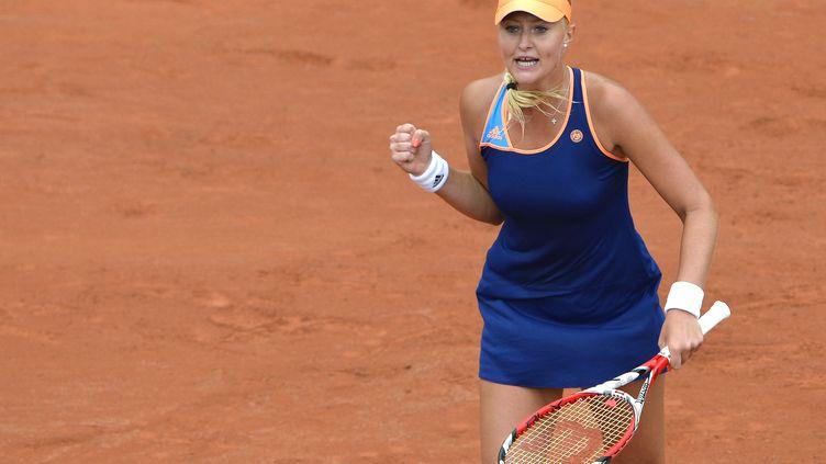 La Française Kristina Mladenovic, après sa victoire sur la Chinoise Li Na, numéro 2 mondiale, le27 mai 2014, au premier tour du tournoi deRoland-Garros (Paris). (MIGUEL MEDINA / AFP)
