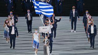 La Grèce, lors de la parade des nations, à la cérémonie d'ouverture des Jeux olympiques de Tokyo, au Stade olympique de Tokyo (Japon), le 23 juillet 2021. (BEN STANSALL / AFP)