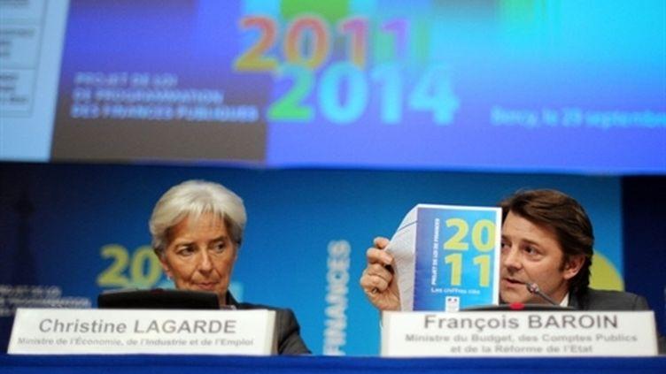 Christine Lagarde (g) et Francois Baroin présentent à la presse le projet de budget 2011, le 29/09/2010. (AFP - Lionel Bonaventure)