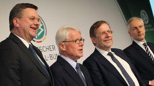 Les membres de la DFB (la Fédération allemande de football),Reinhard Grindel, Reinhard Rauball, Rainer Koch etChristian Duve, le 4 mars 2016 à Francfort. (DANIEL ROLAND / AFP)