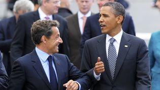 Nicolas Sarkozy, alors président de la République, et son homologue américain Barack Obama à Deauville (Calvados), le 26 mai 2011. (PHILIPPE WOJAZER / AFP)