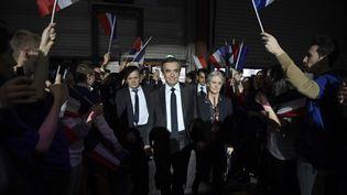 François Fillon et son épouse Penelope Fillon le 29 janvier 2017 à Paris, lors d'un meeting du candidat des Républicains à la présidentielle. (ERIC FEFERBERG / AFP)