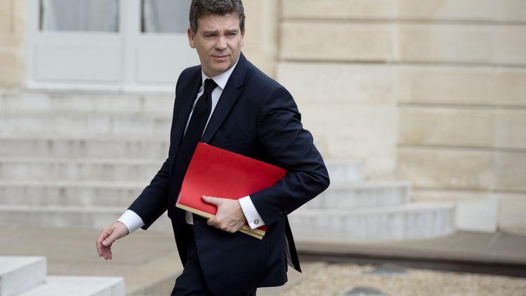 Le ministre de l'Economie, Arnaud Montebourg, lors de son arrivée à l'Elysée (Paris), pour rencontrer le patron de General Electric, lundi 28 avril 2014. (ALAIN JOCARD / AFP)