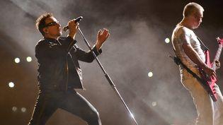 Bono et Adam Clayton du groupe U2 à Mexico City, en mai 2011  (A.ESTRELLA/AFP)
