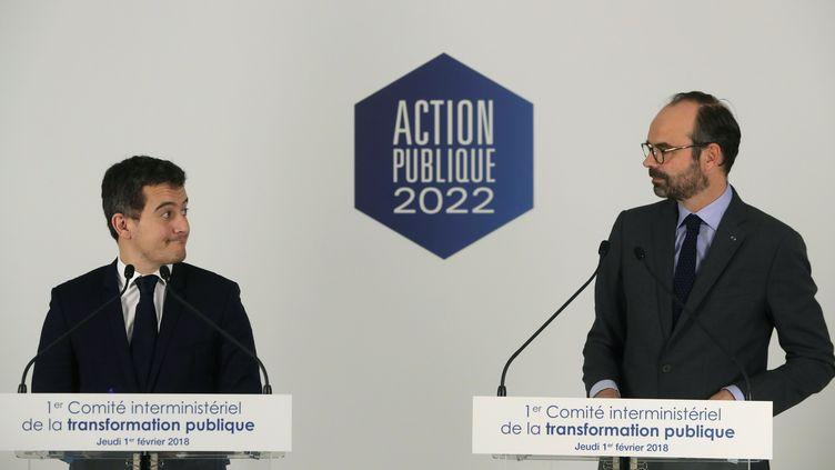 Le ministre de l'Action et des Comptes publics, Gérald Darmanin, et le Premier ministre, Edouard Philippe, lors d'une conférence de presse à Paris, le 1er février 2018, à l'issue du comité interministériel de la transformation publique. (JACQUES DEMARTHON / AFP)