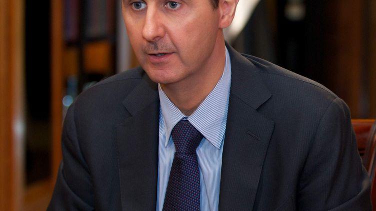 Le président syrien, Bachar Al-Assad, lors d'une interview à la chaîne libanaise Al-Mayadeen, à Damas (Syrie), le 21 octobre 2013. (SANA / AFP)