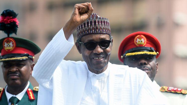 Le président Buuhari lors d'une parade militaire à Abuja le 12 juin 2019. (PIUS UTOMI EKPEI / AFP)