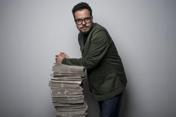 """Nicolas Demorand pose au siège de """"Libération"""", le 4 setembre 2013. (FRED DUFOUR / AFP)"""