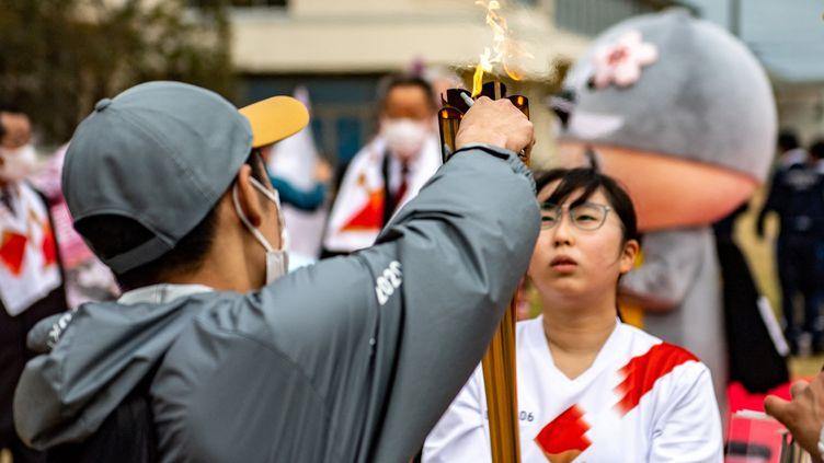 10 ans après la catastrophe, Fukushima a accueilli le départ du relais de la flamme olympique. (PHILIP FONG / AFP)