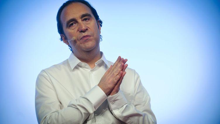 Le président de Free, Xavier Niel, le 10 janvier 2012 à Paris, à l'occasion de la présentation de l'offre Free Mobile. (CHRISTOPHE PETIT TESSON / MAXPPP)